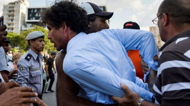 Cuban police arrest demonstrators taking part in the LGBT march in Havana, 11 May 2019