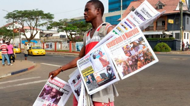 A man selling papers in Liberia's capital, Monrovia - 29 December 2017