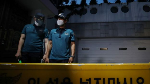 """South Korean policemen stand guard in front of Seoul Mayor Park Won-soon""""s residence in Seoul, South Korea, July 9, 2020."""