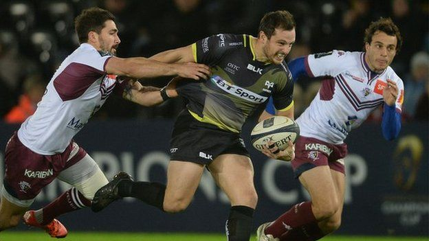 Dan Evans of Ospreys is tackled by Felix Le Bourhis