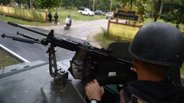 A Thai soldier takes up position outside the Rattanaupap temple in Narathiwat province, 19 January 2019