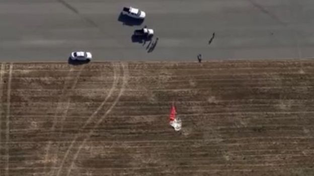 The pilot's parachute was located in a nearby field