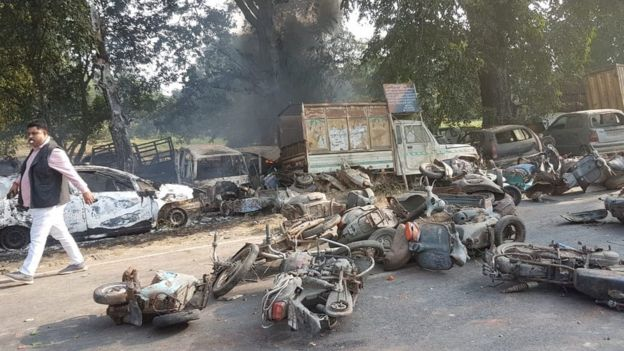 Burnt motorcycles and vehicles on the street