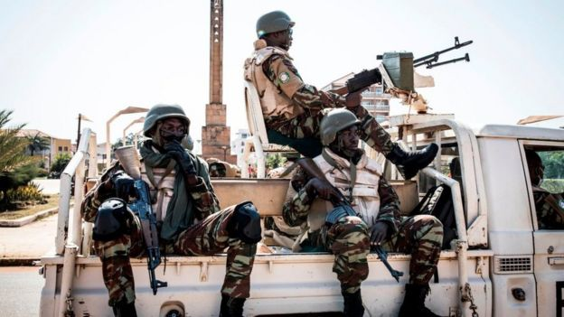 Soldiers from the Economic Community of West Africa States's (ECOWAS) security mission in Guinea-Bissau (ECOMIB) wait in their truck outside the presidential palace in Bissau on November 24, 2019