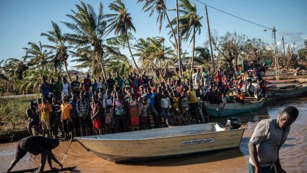 People stranded by Cyclone Idai wait for rescue by the Indian Navy on March 22