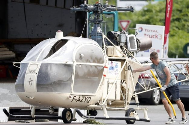 Investigators transport an Alouette II helicopter allegedly abandoned by French prisoner Redoine Faid and his suspected accomplices after his escape