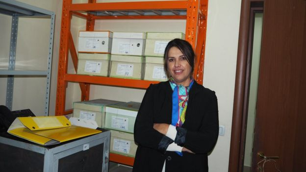 Gentjana Sula with some of the Sigurimi files