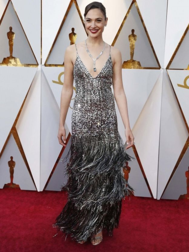 Wonder Woman actress Gal Gadot wears a strappy silver Givenchy couture dress on the Oscars red carpet