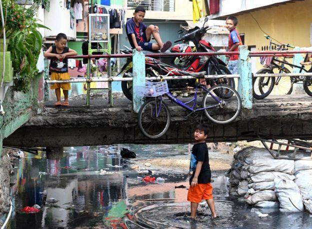 Children in kampungs, overly populated neighbourhoods.