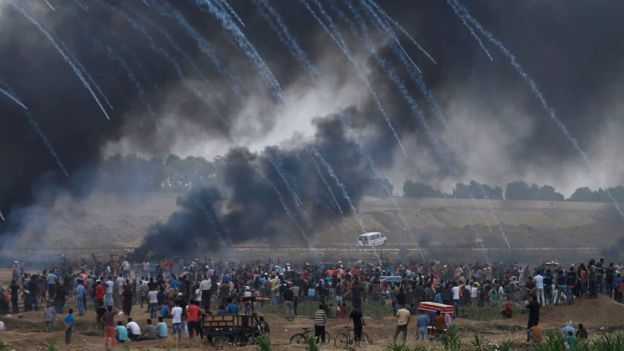 Tear-gas canisters are fired by Israeli forces at Palestinians at a protest on the Gaza-Israel border fence on 4 May 2018