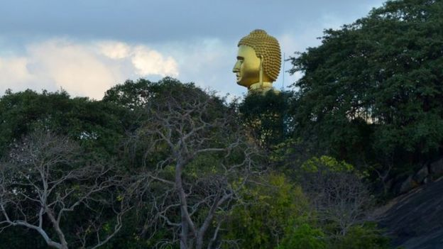 A Golden Buddha statue towers at the Rock Temple, also known as the A Golden Buddha statue towers at the Rock Temple, also known as the Rangiri Dambulla Rajamaha Viharaya, in Dambulla, some 150 kms north of Colombo, in Dambulla, some 150 kms north of Colombo