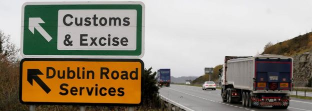 A lorry is passing a sign on a main road outside Newry, Northern Ireland
