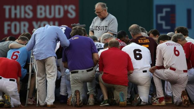 Fr Conroy (centre) led a prayer one day after a shooting at a congressional softball practice