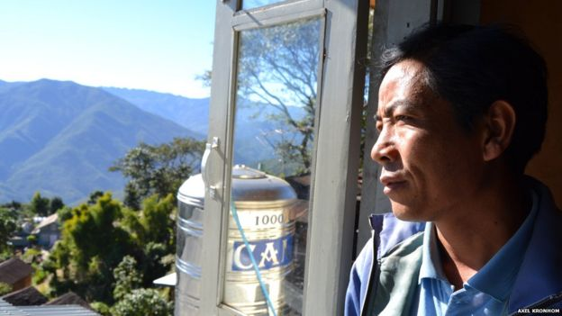 Ex-opium farmer looks out onto agricultural land