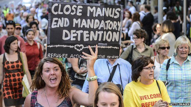 A group of people hold placards during a protest in Melbourne, Australia on 22 January, 2015 to support the Manus Island asylum seekers and call for an end to offshore processing
