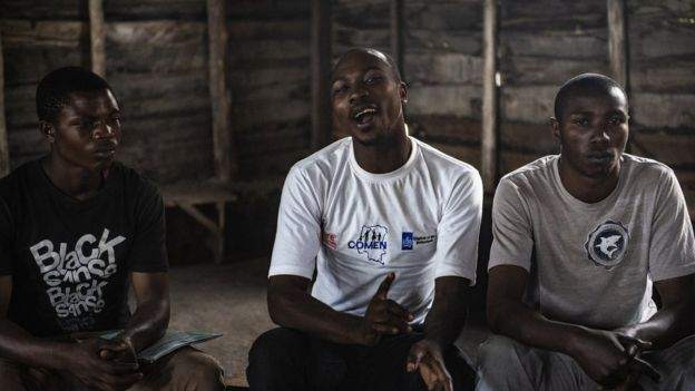 Men argue about masculinity and virility in a meeting organized by the Network of Congolese Men.