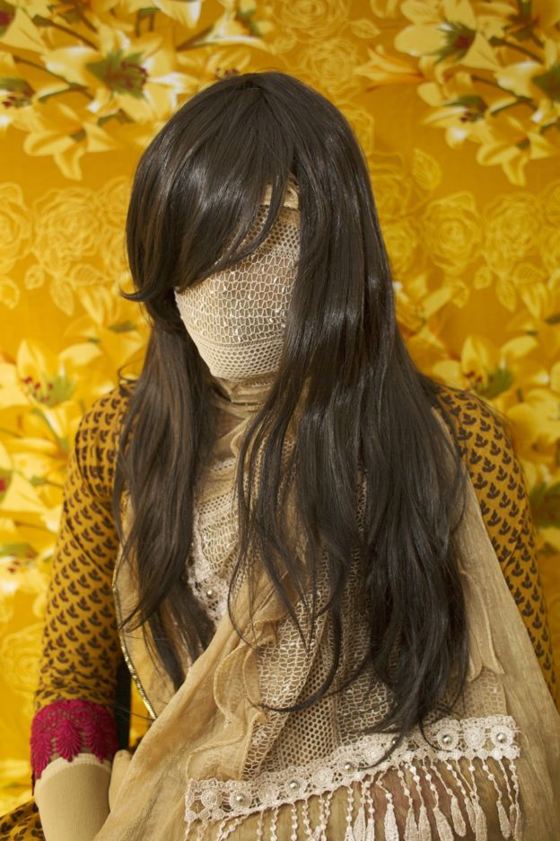 Bangladeshi woman with face covered in gold