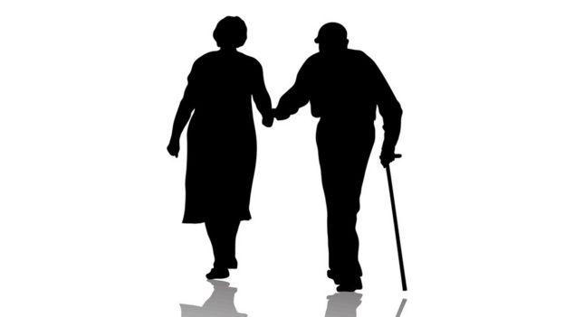 Silueta de una pareja de ancianos.