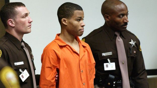 Eighteen-year old sniper suspect Lee Malvo, (C), who was 17 at the time of the alleged crimes, appears in court during the trial of sniper suspect John Muhammad in Virginia Beach, Virginia, U.S. on October 22, 2003.