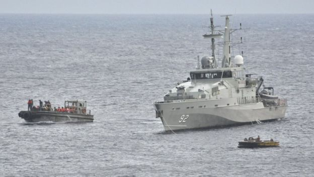 An Australian Navy vessel pictured beside an asylum seeker boat