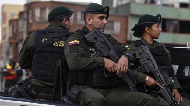 Security forces patrol near the site of an explossion
