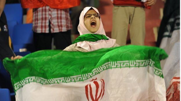Girl with Iranian flag in a game between Iran and Saudi Arabia
