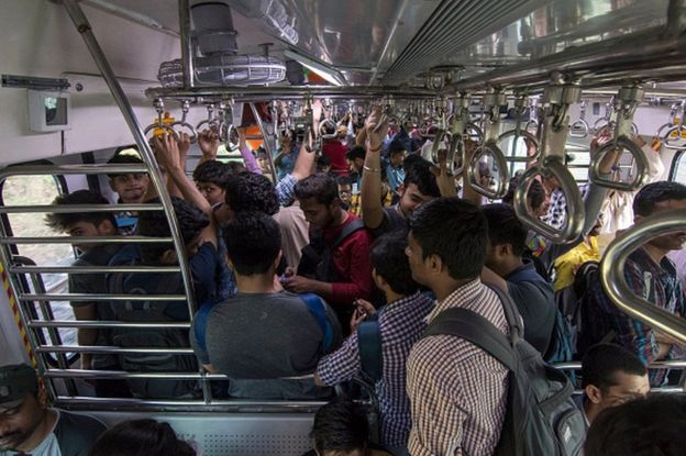 People travel in Central Railway's first air-conditioned EMU local train, on January 30, 2020 in Mumbai, India.