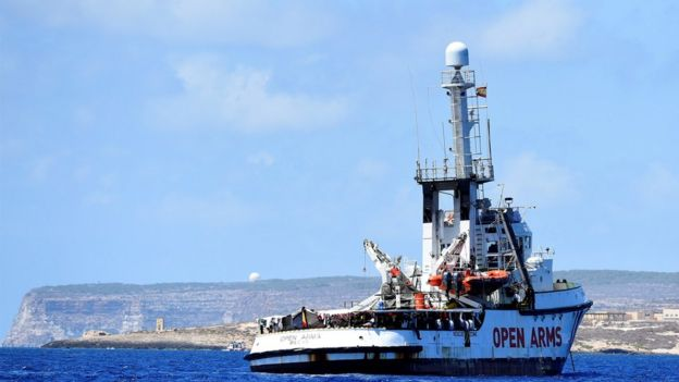 "Spanish migrant rescue ship Open Arms is seen in front of the ""Door to Europe"" monument, close to the Italian shore in Lampedusa"