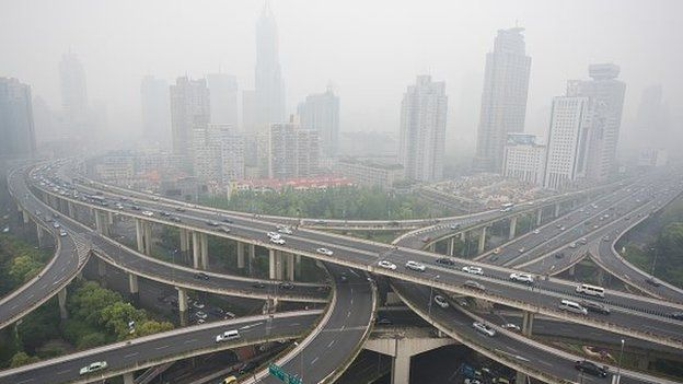 Cars are seen on an elevated road on a heavy polluted day in Shanghai on April 19, 2015. AFP PHOT