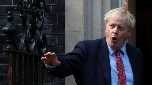 Boris Johnson standing outside Number 10 Downing Street