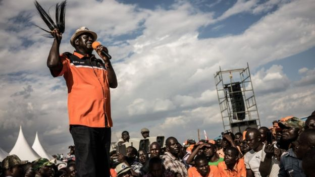 Kenyan presidential candidate Raila Odinga gestures as he addresses supporters at a rally held by his coalition party The National Super Alliance (NASA) in Kisumu on August 3, 2017.