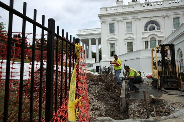 workers dig up pavement