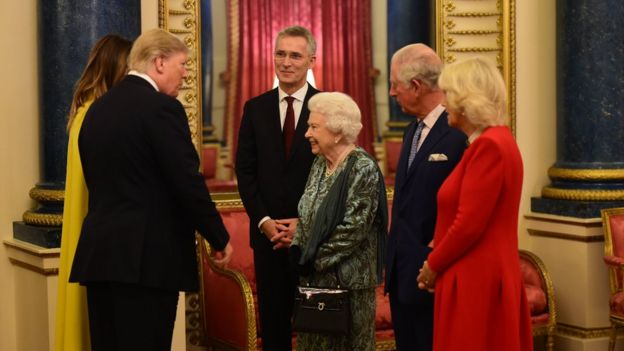The Queen talks to US President Donald Trump and wife Melania as she hosts a reception for Nato leaders at Buckingham Palace