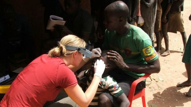 Dr Anna Last examining a patient for trachoma