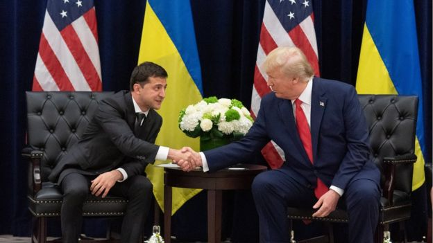 Ukraine's President Volodymyr Zelensky and US President Donald Trump shake hands during a meeting in September