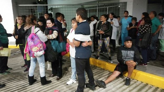 People gather outside a hospital in Mexico City after the quake