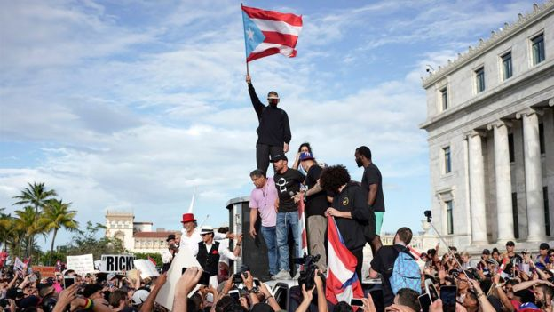 Protesters take part in a demonstration in San Juan