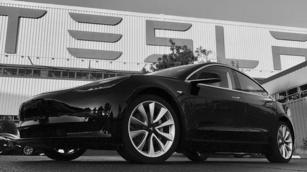 A Tesla Model 3 outside the company's factory in California