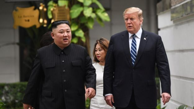 US President Donald Trump (R) walks with North Korea's leader Kim Jong Un during a break in talks at the second US-North Korea summit at the Sofitel Legend Metropole hotel in Hanoi on 28 February, 2019.