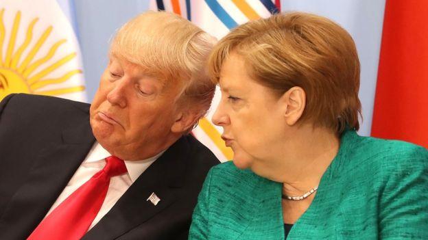 2017年G20峰会上,美国总统特朗普和德国总理默克尔交谈