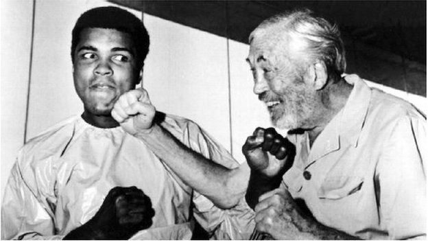 Ali in playful mood with film director John Huston