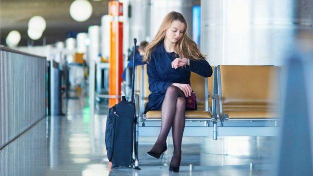 Woman waiting at an airport