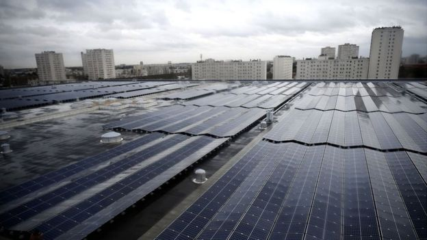 The largest photovoltaic power plant on a rooftop in the Ile de France region is pictured during its inauguration on the roof of the drinking water reservoir in L'Hay-les-Roses, south of Paris, on December 14, 2017