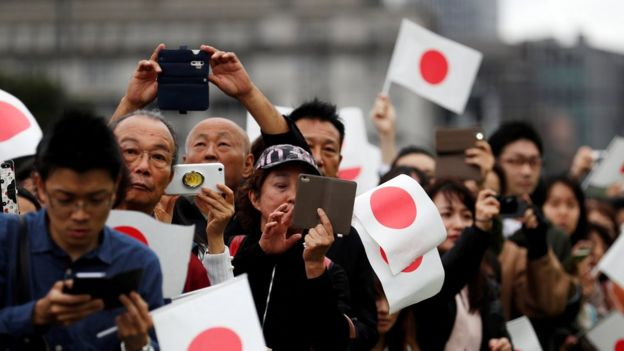 """People wait outside the Imperial Palace after the enthronement ceremony of Japan""""s Emperor Naruhito in Tokyo"""