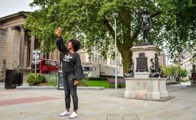 Jen Reid next to the statue