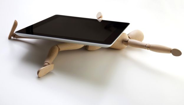 Concept photo - a mannequin being crushed by a with tablet