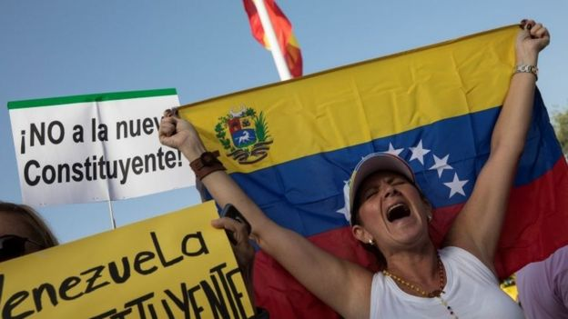 A woman shouts slogans during a protest held by Venezuelans in Spain against Venezuela's Constituent Assembly election, in Madrid, Spain, July 30, 2017.