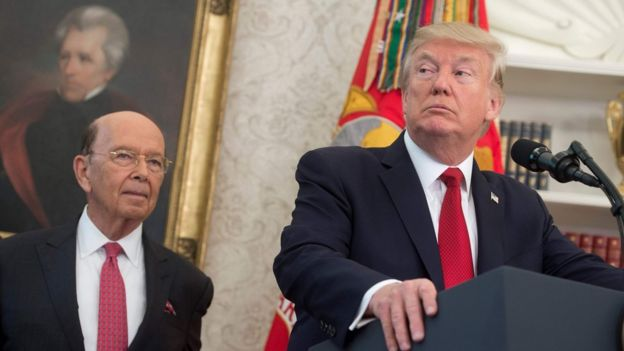 US President Donald Trump speaks alongside Secretary of Commerce Wilbur Ross (L) about his tax reform proposal prior to meeting with winners of the National Minority Enterprise Development Week Awards Program in the Oval Office of the White House in Washington, DC, October 24, 2017