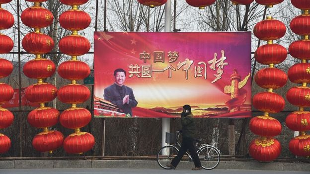 Poster with the photo of Xi Jinping