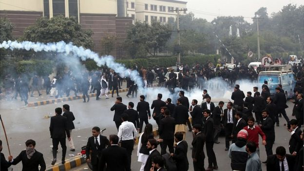 Police fire tear gas during clashes between lawyers and doctors outside the Punjab Institute of Cardiology in Lahore, 11 December 2019